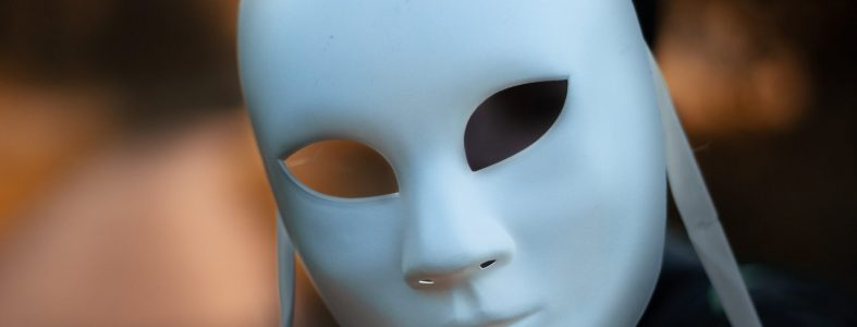 focus-photography-of-white-mask-2375034
